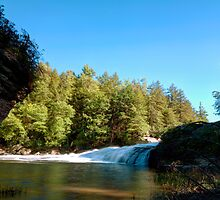 Blue Skies Over Swallow Falls by Gene Walls