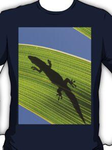 Silhouette Of A Phelsuma Day Gecko On A Palm Leaf. T-Shirt