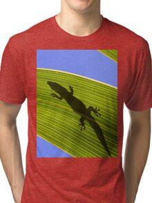 Silhouette Of A Phelsuma Day Gecko On A Palm Leaf. Tri-blend T-Shirt