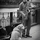 Busker and Friend by Les Unsworth