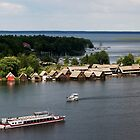 Boat houses on Müritz lake at Roebel, Mecklenburg, Germany. by David A. L. Davies