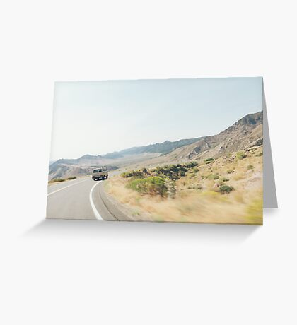 Camper Van Driving Through Dry Landscape Greeting Card