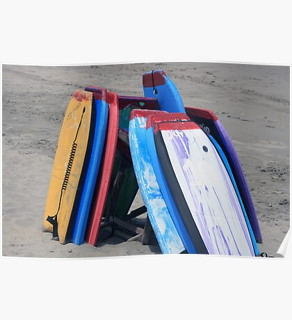 Stacked Boards on a Beach Poster