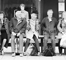 Bus stop queue by Trevor Coultart