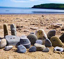 Beach pebble people by Trevor Coultart