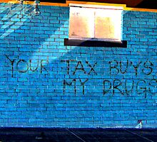 Street art - Your tax buys my drugs by Kate Carey Peters