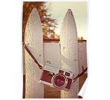 Vintage film camera on picket fence Poster