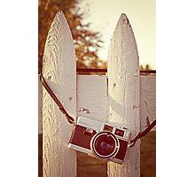 Vintage film camera on picket fence Photographic Print