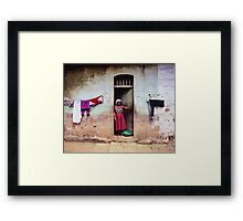 Woman In Front Of The House Framed Print