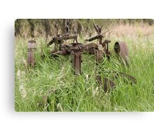 Antique Plow Overgrown in a Field Canvas Print