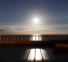 Whitby - moonrise through the East pier by PaulBradley