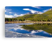 Mountain Reflection in Partially Frozen Lake Canvas Print