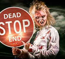 Halloween portrait. Scary zombie holding stop sign by Ryan Jorgensen