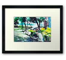 Cycle in puddle Framed Print