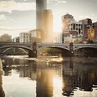 Rowers on the Yarra River at Sunset by jamjarphotos