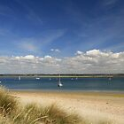 Boats anchored off the beach by Judi Lion