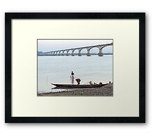Boatmen at the river bank Framed Print