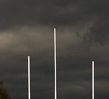 3 White Poles on a Stormy Day by Nazareth