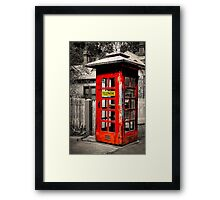 The old telephone cabin Framed Print