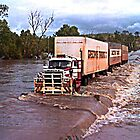 Truck crossing Ord River in flood by Julia Harwood