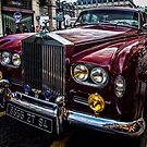 A red Rolls Royce parked on the street in Paris. by Sven Brogren