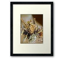 On Top Of Dried Flowers. Framed Print