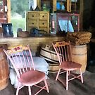 Americana - Two Pink Chairs in General Store by Susan Savad