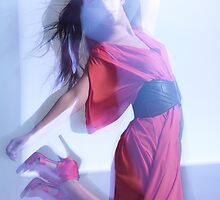 Fashion Photo of Woman in Red Dress Jumping in Blue Light art photo print by ArtNudePhotos