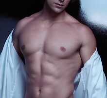 Portrait of a muscular sexy young man with bare torso art photo print by ArtNudePhotos