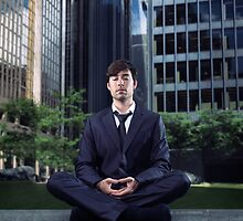 Young businessman meditating in city downtown art photo print by ArtNudePhotos