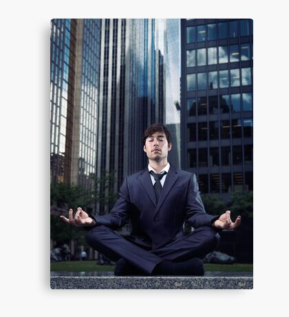 Businessman meditating with office buildings behind him art photo print Canvas Print