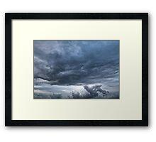 Dark rolling clouds Framed Print