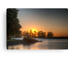 Sundown over an lake Canvas Print