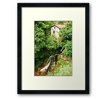 Abandoned Building by Stream Framed Print