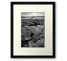 rock formations with castle in black and white Framed Print