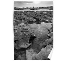rock formations with castle in black and white Poster