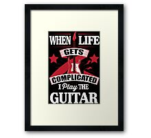 When life gets complicated I play the guitar Framed Print