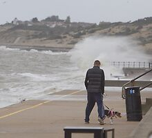 Dog walker Stormy Sea at Herne Bay  Kent by Keith Larby