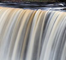Over the Edge - Upper Tahquamenon Falls, Michigan by Kenneth Keifer