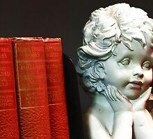 Angel on a bookshelf by Brendagpotash