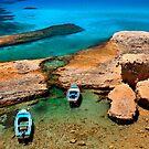 Natural rocky harbor in Milos island by Hercules Milas