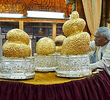 Buddhafigures with thick layer of gold leaf in Phaung Daw U Pagoda by travel4pictures