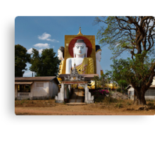 four sitting Buddhas 30 metres high looking in four points of the compass at Kyaikpun Pagoda Canvas Print
