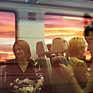 Reflections on a train at dusk by Berns