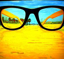 Yellow glasses on the dock of the bay by VENMARTA