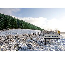 an ghaeltacht sign in irish snow covered scene Photographic Print