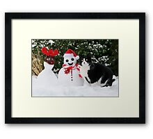 Cat by the side of Santa snowman Framed Print