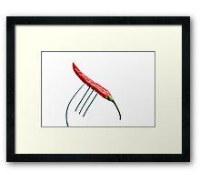 red chili pepper on a fork over white Framed Print