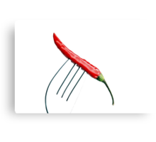 red chili pepper on a fork over white Canvas Print