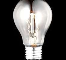 electric bulb lightened isolated on black background by keko64